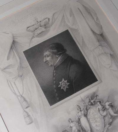 Framed engravings of King George III and his wife Charlotte