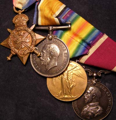 1914 Star Medal Trio & Long Service Medal. Scots Guards.POW.