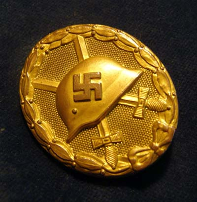 A Wound Badge in Gold. Numbered '30'